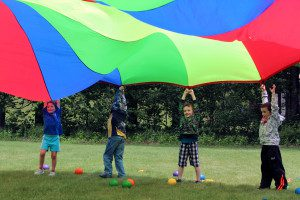 Students with parachute on PE fun day