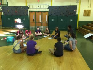 WEB students sit in the gym