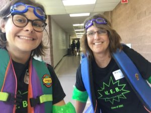 Teachers pose in the hallway