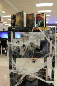 Book cart with spider web decorations