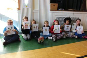 3rd Grade students hold up Responsibility Trait they will speak about
