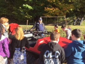 Students check out a four-wheeler