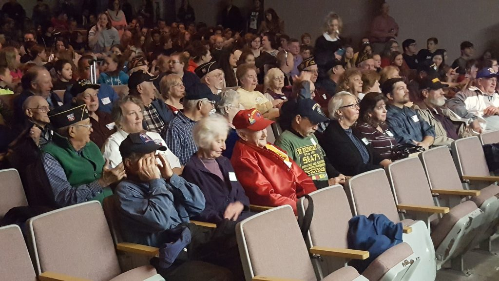 Local veterans and their guests fill the auditorium