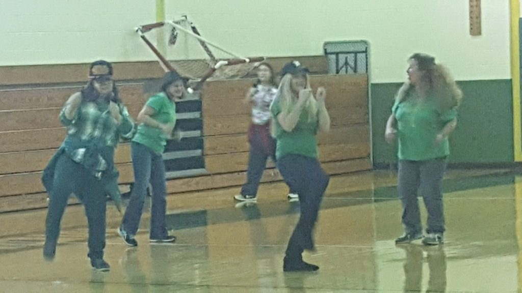 Teachers dance in the gymnasium
