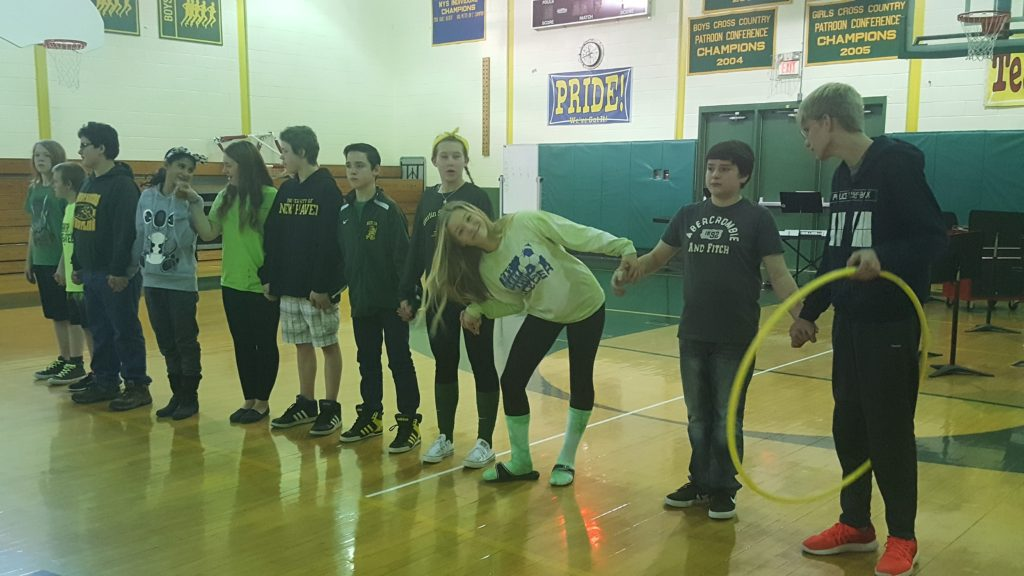 Students line up in the gymnasium before a game