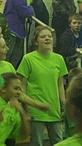 A student wears a green Mountaineer t-shirt