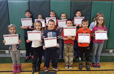PE Students of December holding their certificates