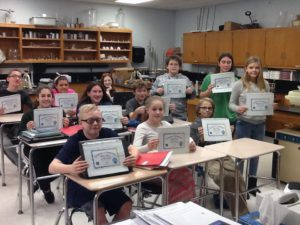 Students holding hour of code certificates
