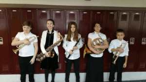 Students who performed are seen holding their instruments