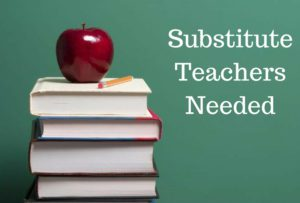 Chalk board with apple and text that says substitute teachers needed