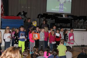 Kindergarten students singing at honesty assembly