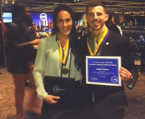 Maria and Stephen hold certificates