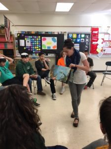 Music teacher Ms. Labnon reading to students