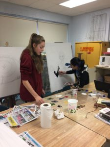Students working in art class
