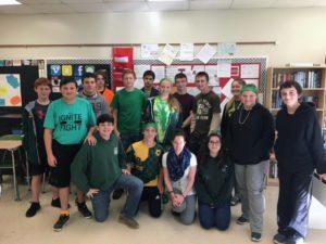 Students posing with music teacher Mr. Labnon