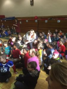 Kindergarten teacher Kasey Hannigan asks students questions during Jeporady style game