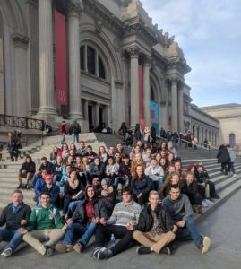 STudents on the steps if the museum