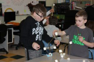 students building marshmallow tower