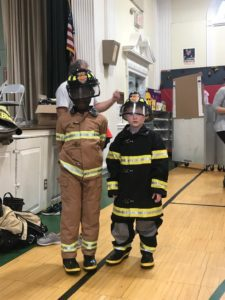 Studnets dressed in firefighter gear