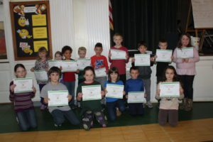 students holding their awards