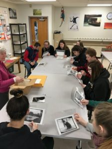 students looking at old photos