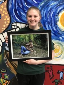 "Maddy Crandall (Grade 11) with a digital photograph titled ""Fall Into Our Future."""
