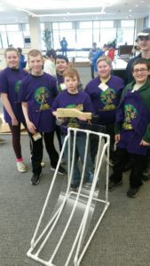 Middle School team members (l-r) Riley Smith, Raymond Ericson, Daniel Rivera, Alex Chrisikos, Logan Dunlop, Charlie Brand and Connor Sniger (back right) with their gravity-powered vehicle.