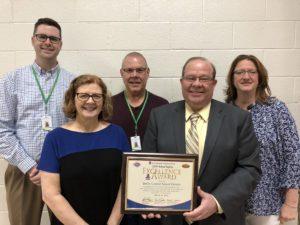 Administrators holding award