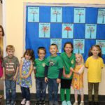 students wearing green